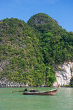 Beautiful Island with longtail boat in Phang Nga Bay. Thailand Royalty Free Stock Photography