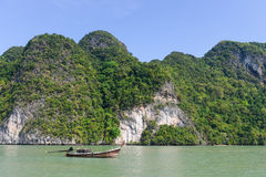 Beautiful Island with longtail boat in Phang Nga Bay. Thailand Stock Photo