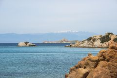 Maddalena island near sardinia in italy. The beautiful island of maddalena , compared with the maledives, with blue sea and the mountains as background, you Stock Image