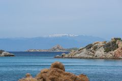 Maddalena island near sardinia in italy. The beautiful island of maddalena , compared with the maledives, with blue sea and the mountains as background, you Royalty Free Stock Photo