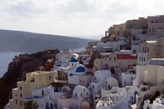 Beautiful island of Santorini, Greece. Traditional white greek houses against the backdrop of the sea. The city of Oia on the stock image