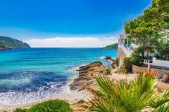Picturesque seascape at coast of Sant Elm on Mallorca island. Beautiful island scenery, luxury villa at beach with idyllic sea view at seaside of Majorca Royalty Free Stock Photos