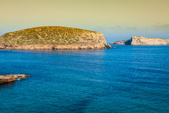 Beautiful island and turquoise waters in Cala Conta, Ibiza Spain Stock Photography