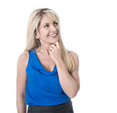 Beautiful isolated mature woman in blue - happy and looking side royalty free stock photo