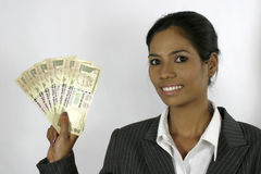 Beautiful isolated person holding money Royalty Free Stock Photography