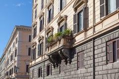 Beautiful Italian balcony. Beautiful traditional Italian balcony with plants at the street Stock Images