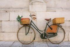 Beautiful italian bicycle. With baskets Stock Photos