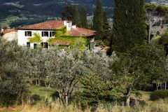 Beautiful Italian villa in the green garden royalty free stock images