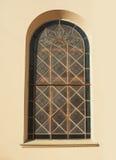 Beautiful Italian windows on blue building facade.  Royalty Free Stock Photo