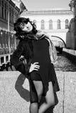 Beautiful italian woman on the embankment Stock Images