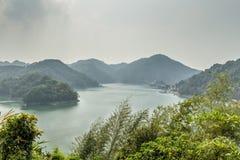 Beautiful jade green lake lake surrounded by mountains Royalty Free Stock Image