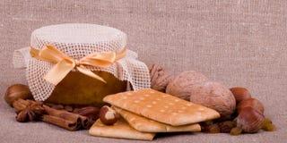 Beautiful jam, cupcakes and nuts Stock Photos