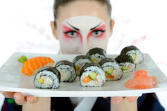Beautiful japan geisha woman with sushi Stock Image