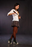 Beautiful japan girl. Beautiful japan schoolgirl with katana in her hand Stock Image