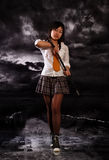 Beautiful japan girl. Beautiful japan schoolgirl with katana in her hands royalty free stock photography