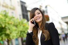 Beautiful japanese business woman in urban background on the phone stock images
