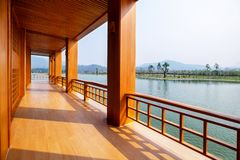 Beautiful Japanese Conservative Wood Terrace and Fence with Outdoor Pagola and Lake.  stock photos