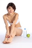 Beautiful Japanese girl with green apple and water Royalty Free Stock Image