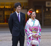 Beautiful Japanese girl kimono man suit. Young Japanese woman in kimono and man in suit on Coming of Age Day (seijin no hi). The Coming of Age ceremony (seijin Royalty Free Stock Image