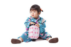 Beautiful japanese kimono little girl isolated on white backgrou Royalty Free Stock Photos