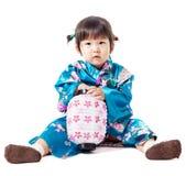 Beautiful japanese kimono little woman. Royalty Free Stock Image