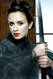 Beautiful japanese kimono woman with samurai sword Stock Photography