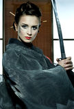Beautiful japanese kimono woman with samurai sword Royalty Free Stock Photo