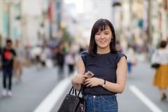 A beautiful Japanese Lady in the City. A beautiful Japanese Lady in the City smiling at the camera stock photo