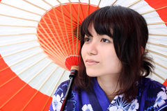 Beautiful Japanese with traditional umbrella. A young beautiful Japanese woman wearing a flower kimono and traditional umbrella in a park on Odaiba Island, Tokyo Stock Photography