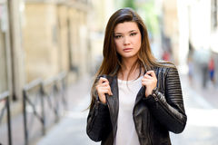 Beautiful japanese woman in urban background wearing leather jac Stock Photo