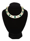 Beautiful jewellery necklace with green stone on black mannequin Stock Photo