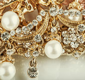 Beautiful jewelry background with gold and pearls Royalty Free Stock Photo