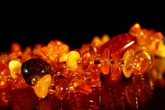 Beautiful jewelry beads made of natural amber. Close up.  Stock Photos