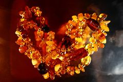 Beautiful jewelry beads made of natural amber. Close up.  Stock Images