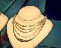 Beautiful jewelry - gold necklace on the mannequin. Stock Photography