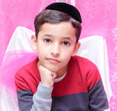Beautiful Jewish boy with a black yarmulke, kippa in Hebrew Royalty Free Stock Photo