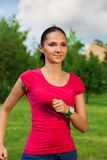 Beautiful jogger in pink t-shirt Stock Image