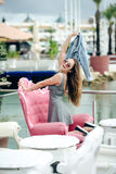 Beautiful joyful happy smiling pretty female in restaurant on luxury marina background. Stock Image