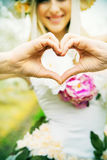 Beautiful joyful lady making the heart sign Stock Images