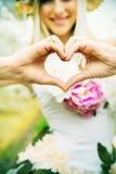 Beautiful joyful lady making the heart sign Stock Images