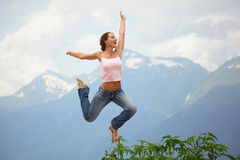 Beautiful joyful woman is jumping. Stock Photography