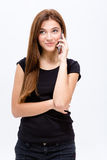 Beautiful joyful young woman talking on mobile phone Stock Photos
