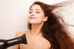 Beautiful joying girl drying long hair Stock Images