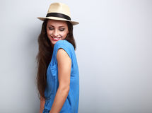Beautiful joying woman with straw hat looking down with natural Stock Photo