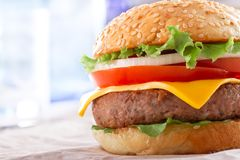 Beautiful and juicy burger close-up. Food is a series of fast-food. Stock Photo