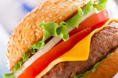 Beautiful and juicy burger close-up. Food is a series of fast-food. Stock Image