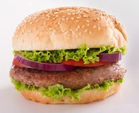 Beautiful and juicy burger close-up. Food is a series of fast-food. Stock Photography