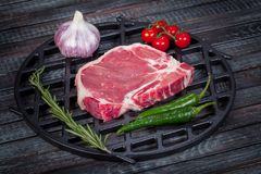 Beautiful and juicy raw steak on the table with ingredients ready to roast stock photography