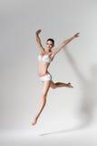 Beautiful jumping woman in white underwear Stock Image