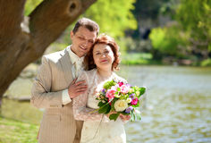 Beautiful just married couple in park Stock Image